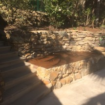 Timber Deck With Sandstone Cladding